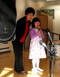 a girl singing with her grandma
